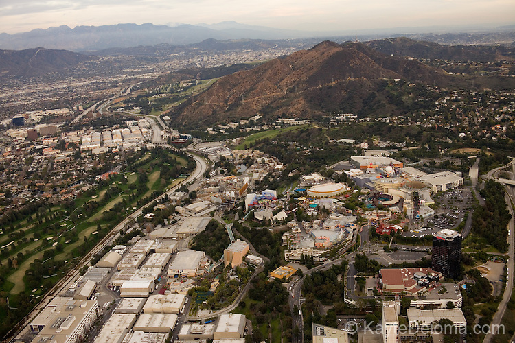 Aerial view of Universal Studios Hollywood, and Warner Bros Studios north of Mt. Lee with Burbank and the San Gabriel Mountains in the distance, seen from Airship Ventures Hollywood Studios Zeppelin Air Tour, Los Angeles, CA