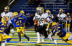 SEYMOUR, CT-112217JS10- Woodland's Nicholas Rousseau (26) runs for a first down though the Seymour defense during their game Wednesday at Seymour High School. Seymour defeated the Hawks  56-8. Jim Shannon Republican-American