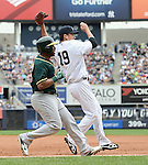 Alberto Callaspo (Athletics), Masahiro Tanaka (Yankees),<br /> JUNE 5, 2014 - MLB :<br /> Alberto Callaspo of the Oakland Athletics grounds out to first as pitcher Masahiro Tanaka of the New York Yankees covers first base in the top of the third inning during the Major League Baseball game at Yankee Stadium in Bronx, New York, United States. (Photo by AFLO)