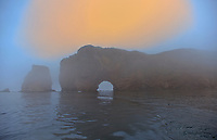 Roche Perce and Atlantic Ocean sin fog at sunrise on Gaspe Peninsula<br /> , Perce, Quebec, Canada