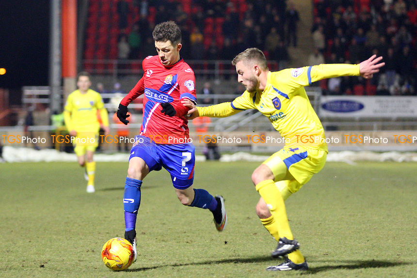 Jamie Cureton of Dagenham and Redbridge and Dan Butler of Portsmouth - Dagenham and Redbridge vs Portsmouth - Sky Bet League Two action at the London Borough of Barking and Dagenham Stadium on 10/02/2015 - MANDATORY CREDIT: Dave Simpson/TGSPHOTO - Self billing applies where appropriate - 0845 094 6026 - contact@tgsphoto.co.uk - NO UNPAID USE