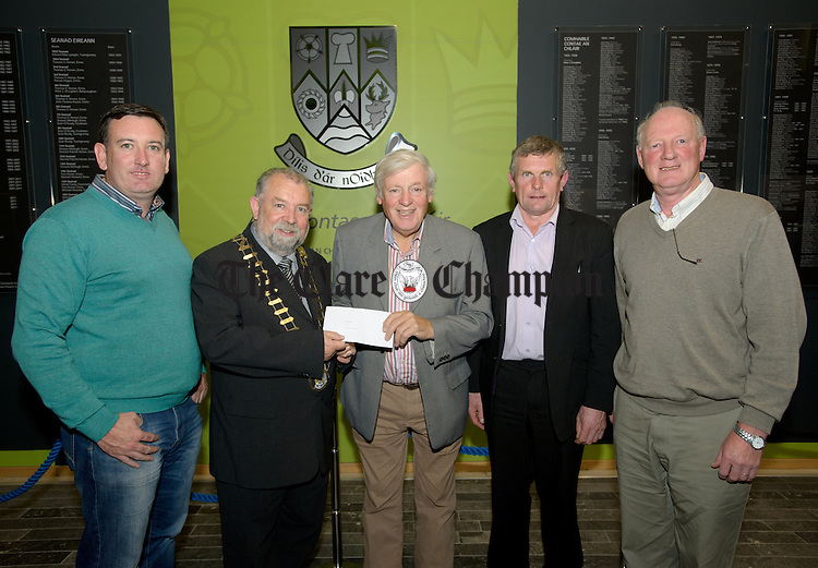 Cathaoirleach of Clare County Council John Crowe presenting the category 1 Clare In Bloom award to Murt Collins of Kilrush Tidy Towns watched by committee member Councillor  Ian Lynch, Councillor Joe Cooney and committee member Sean Moran at the Clare Community Awards prizegiving ceremony at Aras An Chlair. Photograph by John Kelly.