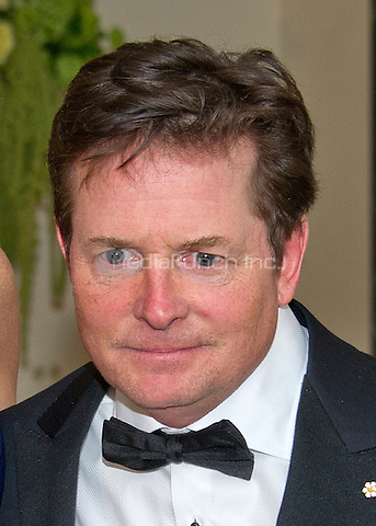 Actor Michael J. Fox arrives for the State Dinner in honor of Prime Minister Trudeau and Mrs. Sophie Gr&Egrave;goire Trudeau of Canada at the White House in Washington, DC on Thursday, March 10, 2016.<br /> Credit: Ron Sachs / Pool via CNP/MediaPunch