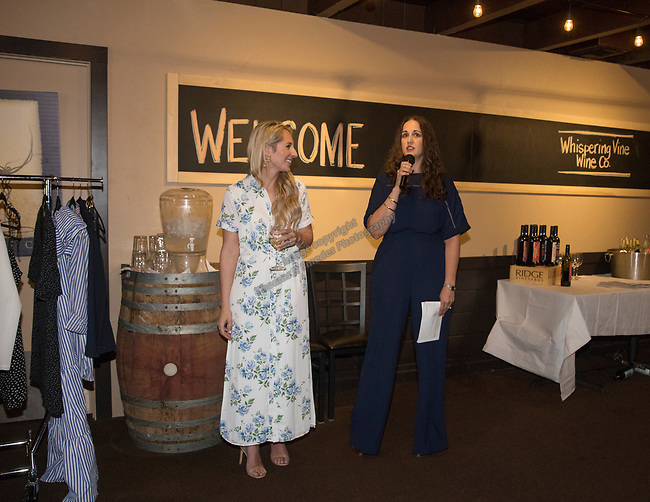 Reno Magazine Editor Laura Longero introduces fashion blogger and Reno Magazine columnist Emily Farren Wieczorek during Reno Magazine's Fall Fashion Styling at the Whispering Vine Wine Co. on Saturday, August 19, 2017.