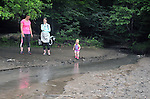 Ann Peters and Ali Troxell, stand watch as, Lucia Troxell, explores the waters of a stream that empties into the Esopus Creek, during a Hike It Baby/ Catskills-Woodstock sponsored hike into the Esopus Bend Nature Preserve in Saugerties, NY, on Memorial Day Monday, May 30, 2016. Photo by Jim Peppler. Copyright Jim Peppler 2016.<br /> The hike was led by HIB.Catskill-Woodstock, Ambassador, Ann Peters, accompanied by her husband, John Peters, their daughter, Violet; HIB chapter co-Ambassador, Ali Troxell, with her daughter, Lucia; and Robin Willens, and her son, Landon. They entered at the Sterley Avenue entrance and walked thru to the landing area on the Esopus.