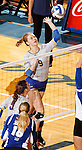 BROOKINGS, SD - SEPTEMBER 1:  Carley Gerving #9 from South Dakota State looks to get a kill past the Drake defense in the Jacks home opener Tuesday night at Frost Arena.  (Photo by Dave Eggen/Inertia)