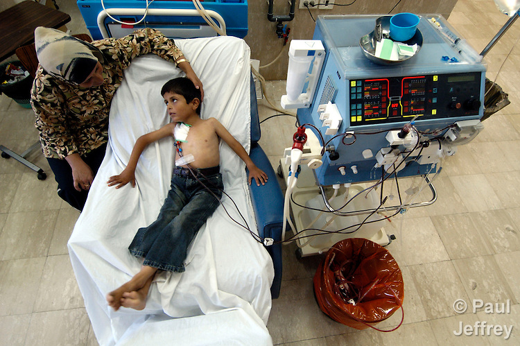 Comforted by his mother, seven-year old Luay Khalil Hawmdeh receives kidney dialysis treatment at East Jerusalem's Augusta Victoria Hospital, run by the Lutheran World Federation..