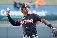 Infielder Tyler Williams (6) of the Kannapolis Intimidators warms up before a game against the Greenville Drive on Friday, April 11, 2014, at Fluor Field at the West End in Greenville, South Carolina. Greenville won, 13-2. (Tom Priddy/Four Seam Images)