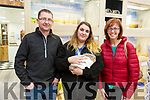 Declan and Margo Piggott from Newmarket with Alyson O'Connor the opening of the Petstop in Manor on Saturday.