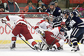 Colin Moore (Harvard - 12), Raphael Girard (Harvard - 30), Danny Fick (Harvard - 7), Kevin Goumas (UNH - 27), Austin Block (UNH - 3) - The Harvard University Crimson defeated the University of New Hampshire Wildcats 7-6 on Tuesday, November 22, 2011, at Bright Hockey Center in Cambridge, Massachusetts.