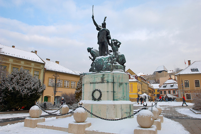 Statue of Dobo in Dobo Square in the snow - Eger - Hungary