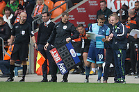 Matt Bloomfield of Wycombe Wanderers looks over some last minute tactical advice before coming on for his 400th game for Wycombe Wanderers replacing the injured Danny Rowe during the Sky Bet League 2 match between Blackpool and Wycombe Wanderers at Bloomfield Road, Blackpool, England on 20 August 2016. Photo by James Williamson / PRiME Media Images.