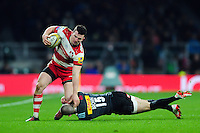 Matt Scott of Gloucester Rugby is tackled by Mike Brown of Harlequins. Aviva Premiership match, between Harlequins and Gloucester Rugby on December 27, 2016 at Twickenham Stadium in London, England. Photo by: Patrick Khachfe / JMP