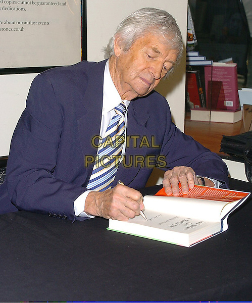 "RICHIE BENAUD.At his new book ""My Spin On Cricket"" signing at Waterstones, Leadenhall Market,.London, 13th September 2005.half length blue navy suit stripe tie author writer autograph product.Ref: CAN.www.capitalpictures.com.sales@capitalpictures.com.©Capital Pictures"