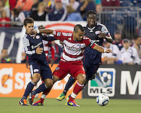 FC Dallas forward Maicon Santos (9) dribbles as New England Revolution midfielder Benny Feilhaber (22) and New England Revolution midfielder Shalrie Joseph (21) defend. In a Major League Soccer (MLS) match, the New England Revolution defeated FC Dallas, 2-0, at Gillette Stadium on September 10, 2011.