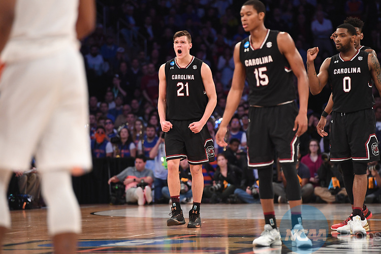 NEW YORK, NY - MARCH 26: Maik Kotsar #21 of the South Carolina Gamecocks reacts during a game against the Florida Gators during the 2017 NCAA Men's Basketball Tournament held at Madison Square Garden on March 26, 2017 in New York City. (Photo by Justin Tafoya/NCAA Photos via Getty Images)