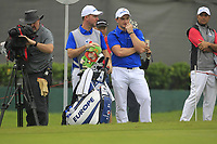 Paul Dunne (Europe) and Darren (caddy) on the 9th green during the Friday Foursomes of the Eurasia Cup at Glenmarie Golf and Country Club on the 12th January 2018.<br /> Picture:  Thos Caffrey / www.golffile.ie