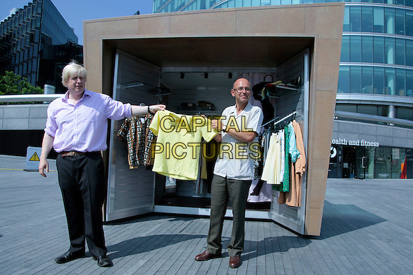 "MAYOR BORIS JOHNSON & WAYNE HEMINGWAY.Outside a 'pop-up-shop' outside City Hall. These 'KioskKiosk"" will provide rent free retail space for fledgling businesses. .July 2nd, 2009.full length clothes sale selling yellow top black trousers pink purple shirt  .CAP/CAS.©Bob Cass/Capital Pictures."