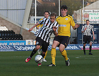 Sander Puri gets the better of Ryan McGeever in the St Mirren v Falkirk Clydesdale Bank Scottish Premier League Under 20 match played at St Mirren Park, Paisley on 30.4.13. .