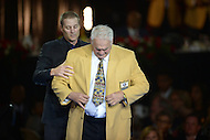 Canton, Ohio - August 6, 2015: Former NFL player Mick Tingelhoff dons his gold jacket for the first time during the 2015 Pro Football Hall of Fame enshrinement dinner in Canton, Ohio August 6, 2015. Tingelhoff played with the Minnesota Vikings from 1962 to 1978, and helped the Vikings attain 10 divisional titles in an 11-season span from 1968 to 1978  (Photo by Don Baxter/Media Images International)