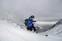 Mann kjører telemark i Seiland nasjonalpark. ---- Man skiing in Seiland National Park.