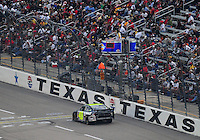 Nov. 8, 2009; Fort Worth, TX, USA; NASCAR Sprint Cup Series driver Jimmie Johnson after crashing during the Dickies 500 at the Texas Motor Speedway. Mandatory Credit: Mark J. Rebilas-