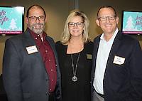 NWA Democrat-Gazette/CARIN SCHOPPMEYER Mat Mozzoni (from left), Annetta Tirey and Mike Luttrell gather at the Northwest Arkansas Community College reception.