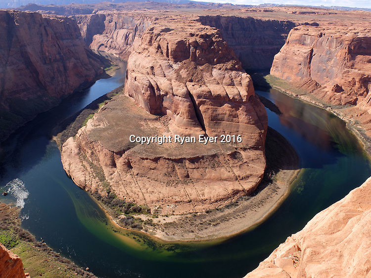 Page, Arizona - 9 March 2016 - Horseshoe Bend is a horseshoe-shaped meander of the Colorado River located near the town of Page, Arizona, in the United States.<br /> <br /> It is located 8 kilometres downstream from the Glen Canyon Dam and Lake Powell within Glen Canyon National Recreation Area, about  6.4 kilometres southwest of  of the town of Page. Picture: Ryan Eyer/APP