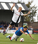 Arnold Peralta goes down on the edge of the box under pressure from Ayr's Robbie Crawford