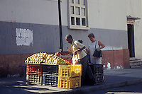 Sidewalk fruit and vegetable vendor in downtown Caracas, Venezuela