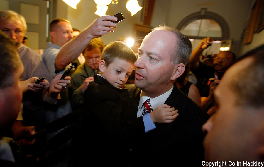 TALLAHASSEE, FL. 8/28/09-LEMIEUX CH10-George LeMieux carries his son Max from the news conference where Gov. Charlie Crist named him to fill the U.S. Senate seat vacated by Mel Martinez, Friday at the Capitol in Tallahassee. LeMieux replaces Martinez who resigned the post and will serve a little more than a year in the role. Crist is running for the U.S Senate seat and hopes to win it in the November 2010 election...COLIN HACKLEY PHOTO