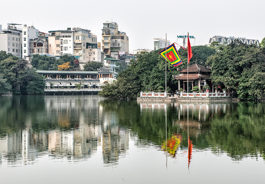 Hoan Kiem Lake is a central feature of Hanoi and is located in the old quarter of the city. On the right is the Temple of the Jade Mountain, located on a small island in the lake.