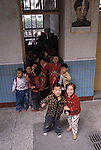 Children at door of first grade classroom; neighborhood elementary school; Chongqing, China, Asia; 041603