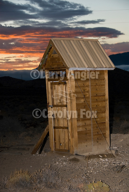 Jeff Pauly's Blue Moon wooden outhouse at dusk, Nevada