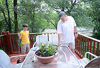 Jeffrey Gunn (right) cleans the back deck with his son Colt Gunn (left), 11  Friday June 19, 2015 in Bensalem, Pennsylvania. For the past 15 years, Gunn has worked out of his home in his job with Meridian. (Photo by William Thomas Cain)