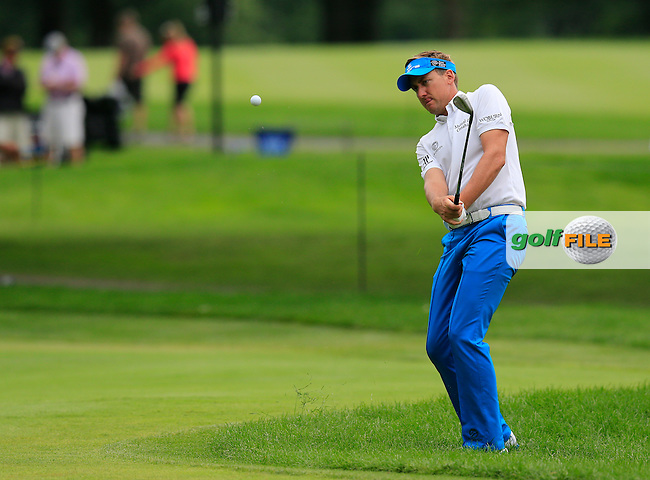 Ian Poulter (ENG) chips onto the 8th green during Friday's Round 1 of the 2013 Bridgestone Invitational WGC tournament held at the Firestone Country Club, Akron, Ohio. 2nd August 2013.<br /> Picture: Eoin Clarke www.golffile.ie