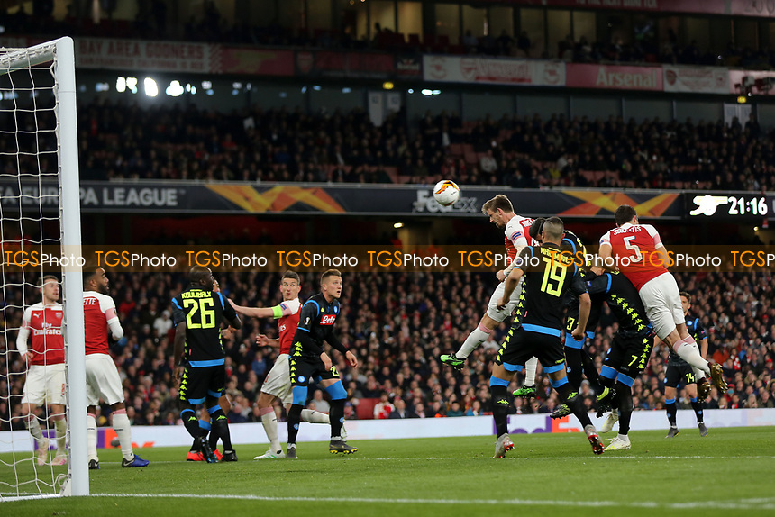 Nacho Monreal of Arsenal heads the ball towards the Napoli goal during Arsenal vs Napoli, UEFA Europa League Football at the Emirates Stadium on 11th April 2019