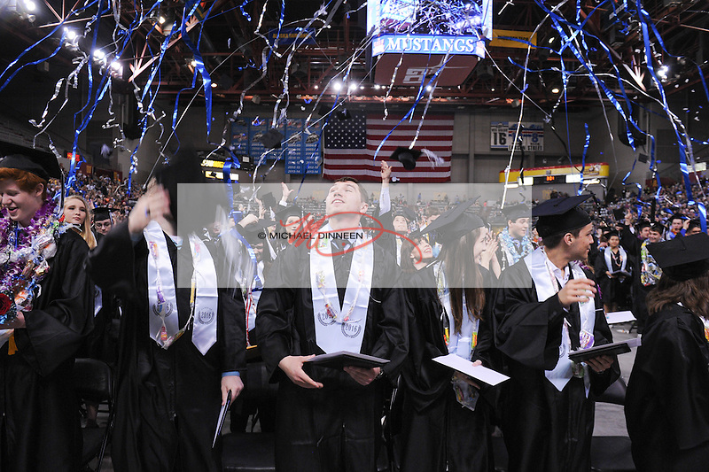 Confetti flies at the Chugiak High School ommencement ceremonies Monday May 9, 2016.  Photo for the Star by Michael DInneen