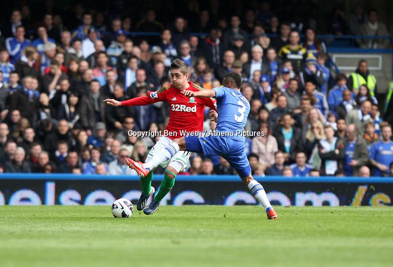 Pictured: Pablo Hernandez runs at Ashley Cole<br /> Barclays Premier League, Chelsea FC (blue) V Swansea City,<br /> 28/04/13