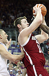 Aron Baynes (#11), Washington State University center, grabs a rebound in front of Jon Brockman during the Cougars Pac-10 conference showdown with the University of Washington on March 7, 2009, in Seattle, Washington.  Both teams came in to the game on a roll, and in a hard fought battle, the Huskies prevailed 67-60 to wrap up the regular season Pac-10 championship.