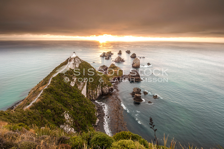 Looking down on the Nuggets lighthouse and rocks at dawn, Otago, South Island, New Zealand - stock photo, canvas, fine art print