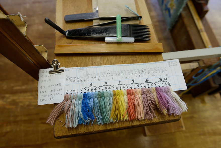 Different coloured wool samples, and tools. Oriental Carpet Mills, Yamanobe-machi, Yamagata, Japan, April 11, 2016. Oriental Carpet Mills was founded in 1935 and produces luxury hand-woven and tufted carpets. Its carpets are used all over the world, including in the Vatican, the Imperial Palace in Tokyo and the Kabukiza Kabuki Theatre.