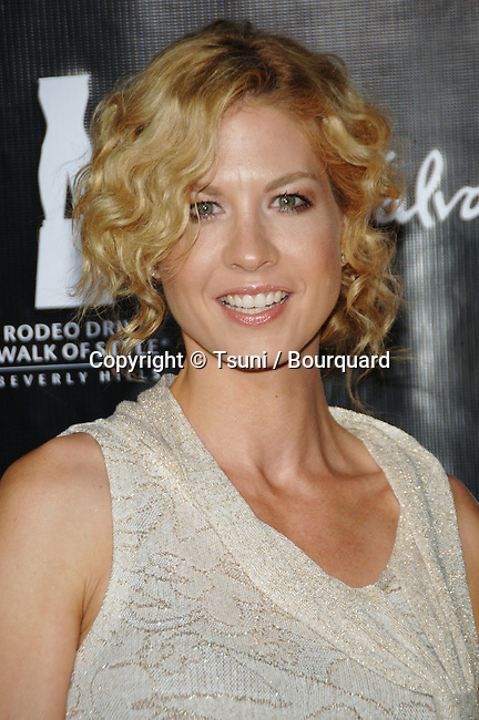 Jenna Elfman arriving at the SALVATORE FERRAGAMO RODEO WALK OF STYLE AWARDS In Los Angeles.<br /> <br /> headshot<br /> eye contact<br /> smile