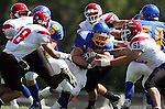 MADISON, SD - AUGUST 30: Andrew Fatten of Dakota State University breaks through the line as John White #51 of Bacone College waits for him in the first quarter of their game Saturday afternoon at Trojan Field in Madison. (photo by Dave Eggen/Inertia)