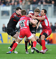 David Strettle is double-tackled. Aviva Premiership match, between Saracens and London Welsh on March 3, 2013 at Allianz Park in London, England. Photo by: Patrick Khachfe / Onside Images