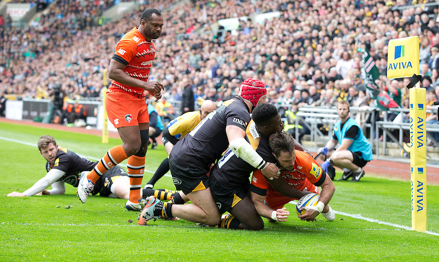 Leicester Tigers' Niall Morris scores his sides first try despite the attentions of Wasps' James Haskell and Christian Wade<br /> <br /> Photographer Stephen White/CameraSport<br /> <br /> Rugby Union - Aviva Premiership - Wasps v Leicester Tigers - Saturday 9th May 2015 - Ricoh Arena - Coventry<br /> <br /> &copy; CameraSport - 43 Linden Ave. Countesthorpe. Leicester. England. LE8 5PG - Tel: +44 (0) 116 277 4147 - admin@camerasport.com - www.camerasport.com