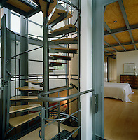 The main spiral staircase connecting all three storeys is a light steel structure with timber treads, surrounded by curved grilles