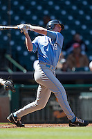 North Carolina Tar Heels third baseman Colin Moran #18 follows through on his swing against the California Golden Bears in the NCAA baseball game on March 2nd, 2013 at Minute Maid Park in Houston, Texas. North Carolina defeated Cal 11-5. (Andrew Woolley/Four Seam Images).