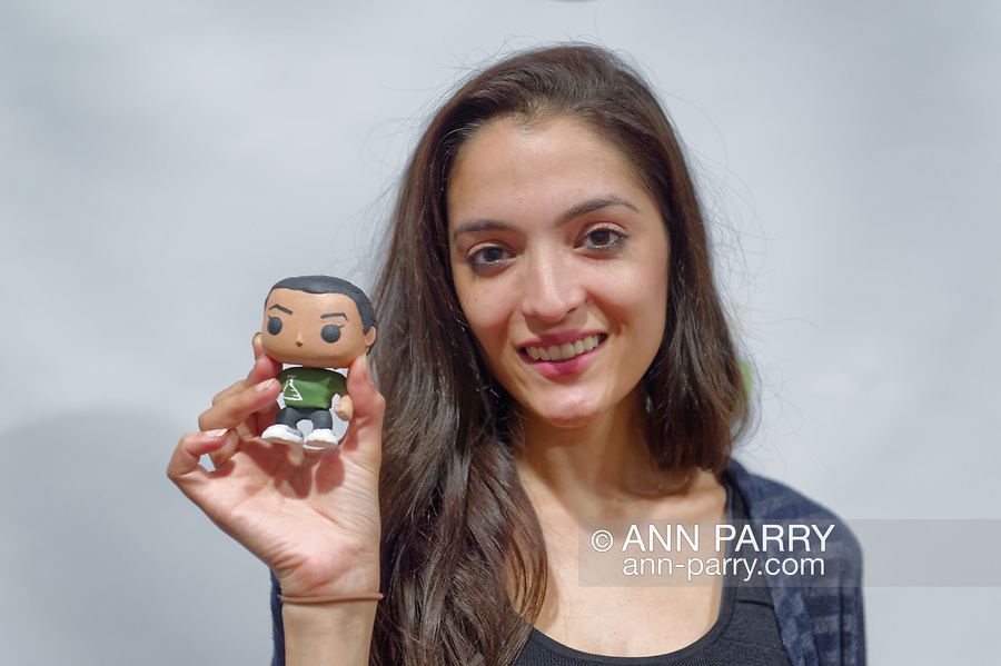 Bellmore, New York, USA. July 18, 2018. AJNA JAI, actor playing title character of The Adventures of Penny Patterson, holds Penny Patterson 'action doll' figure (made by film's director and writer Stephanie Donnelly) after movie screened at LIIFE 2018, the Long Island International Film Expo. The comedy, sci-fi, woman directed film, about a high school student facing obstacles to winning science fair when her boyfriend suddenly becomes a superhero, was nominated at LIIFE for Best Student Film.