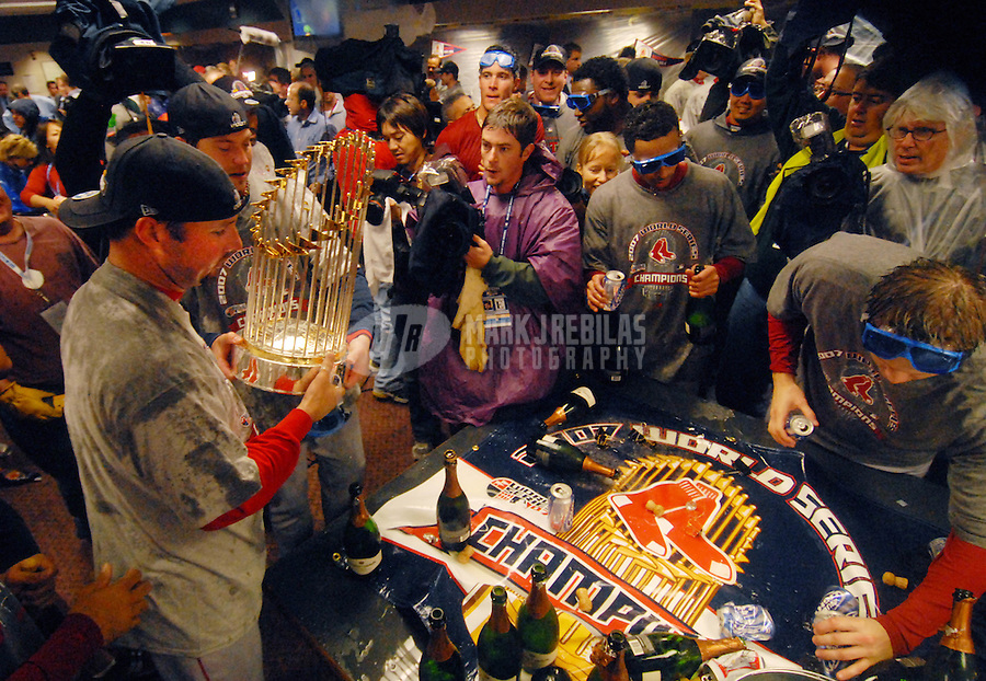 Oct 28, 2007; Denver, CO, USA; Boston Red Sox second baseman Dustin Pedroia celebrate after defeating the Colorado Rockies 4-3 during game 4 of the 2007 World Series at Coors Field. Boston swept Colorado in four games to win the World Series. Mandatory Credit: Mark J. Rebilas-US PRESSWIRE